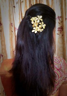Indian bride's bridal hairstyle. Hairstyle by Swank Studio. Find us at https://www.facebook.com/SwankStudioBangalore