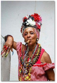 adorned woman smoking cigar, old Havana, Cuba Women Smoking Cigars, Cigar Smoking, Cuban Women, Orishas Yoruba, Photographie Portrait Inspiration, Mode Costume, Havana Nights, Mode Boho, Havana Cuba