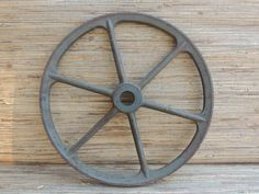 Check out this item in my Etsy shop https://www.etsy.com/listing/398205643/large-15-vintage-cast-iron-pulley-gear