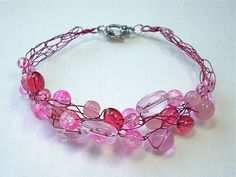 How to crochet with wire and beads.  Wire crochet gives this bracelet a light, lacy appearance.