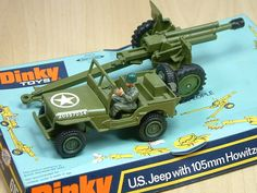 Dinky Toy, US Jeep with 105mm Howitzer. Featured a working cannon that fired plastic shells. This diecast model set was produced between 1968 and 1977.