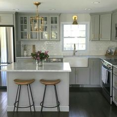 Instead of gray do black lower cabinets and white upper cabinets