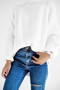 White turtleneck sweater + blue jeans with a classic watch. Love this look.
