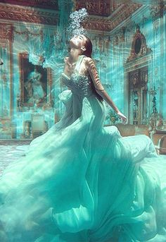 Breathtaking awesome underwater glamor shot! High fashion. Breathless! Aqua teal gown dress.