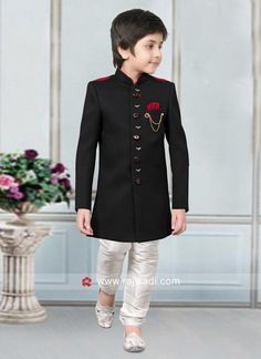 A Black full sleeves Art Silk Kurta comes with contrast White bottom. This Indo Western has fancy buttons and one side pocket highlighted with chain broach. Kids Indian Wear, Kids Ethnic Wear, Kids Party Wear Dresses, Kids Dress Wear, Young Boys Fashion, Kids Fashion, Wedding Dress For Boys, Boys Dressing Style, Kids Dress Collection