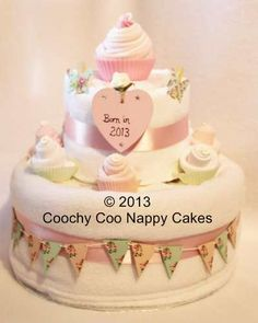 Vintage Tea Party Baby Shower Gift. Our Baby girl nappy cake with miniature wooden bunting makes a stunning centre piece and gift for a tea party baby shower. £45.00 www.coochycoonappycakes.co.uk