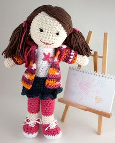 Cute little crocheted doll with accessories.