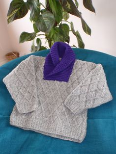 Here's our lovely easy to knit jumper made with grey Donegal wool with soft pure marino collar in various colours. Three children's sizes, complete with easy to read pattern, instruction videos, needles and wool.
