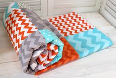 Baby Blanket - Unisex Baby Blanket - Gray, Orange and Aqua Blue Chevron. $49.50, via Etsy.