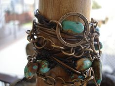 Turquoise Leather Wrap Bracelet, Swag Belt, Leather and Chain Hip Belt with Vintaj Bronze Metal & Natural Turquoise Stones. $160.00, via Etsy.