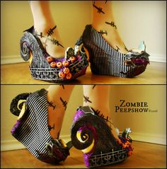 These ZombiePeepshow Nightmare platform wedges are customized with a sculpted hill and textured base. Each shoe features cemetery scenes with fencing, pumpkins, and headstones. Black and white stripe fabric with scattered bats adorn the inside. They were hand painted and custom made for a client, so the final product you receive will have slight variances (ie, positioning and assortment of headstones, varying paint and detail, etc.) Each shoe may have a different style of fencing and hill…