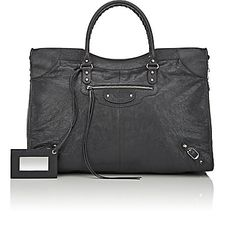 We Adore: The Arena Leather Classic City Extra-Large AJ Bag from Balenciaga at Barneys New York Balenciaga Arena, Balenciaga City Bag, Designer Crossbody Bags, French Brands, Metal Buckles, Large Bags, Barneys New York, Leather Handle, Black Fabric