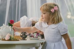 February Savannah Girl: Annabelle from Nashville, TN.   Always ready to play and explore, you can see Annabelle is just full of life. She couldn't wait to join in the tea party!  Annabelle is wearing the Savannah Children dress Blair  available here. http://www.savannahchildren.com/collections/flower-girls/products/blair