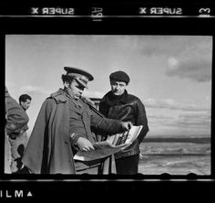 """Robert CAPA. The Spanish Civil War. - Spain. Catalan front. Late December 1938 - early January 1939. General ENRIQUE LISTER and ANDRE MALRAUX (right).   In late December 2007, three small cardboard boxes arrived at the International Center of Photography from Mexico City after a long and mysterious journey. These tattered boxes – the so-called Mexican Suitcase – contained the legendary Spanish Civil War negatives of Robert Capa, Gerda Taro, and David Seymour (known as """"Chim"""")."""