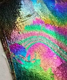 Rainbow Paper - dip black paper in water with a couple drops of clear nail polish, then take outside into the sunlight and look at the rainbow colors