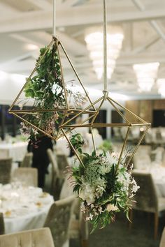 Blooms by Bethan hanging geometric centrepieces. Photography by The Loved Ones