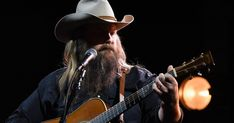 See Chris Stapleton Perform Dark, Dramatic 'There Ain't No Easy Way' Chris Stapleton, Guitar Songs, Country Music, Cowboy Hats, Political News, Easy, Southern, Track, Film