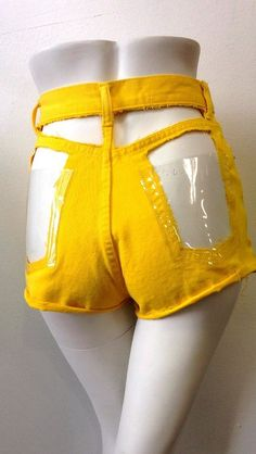 Yellow shorts with clear vinyl back pockets are not for the shy!. DIY the look yourself: http://mjtrends.com/pins.php?name=clear-vinyl-for-shorts_2