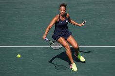 Madison Keys Photos - Madison Keys of USA plays a backhand in her match against Danka Kovinic of Montenegro in the women's first round on Day 1 of the Rio 2016 Olympic Games at the Olympic Tennis Centre on August 6, 2016 in Rio de Janeiro, Brazil. - Tennis - Olympics: Day 1