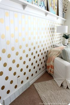 a gold polka dot accent wall this is happening in the baby girls nursery