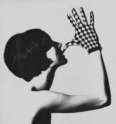 Photo by David Bailey, 1965. like the lighting and shadows the pose is different and the way the model is biting of the gloves is interesting