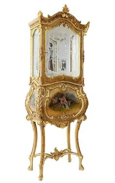 18th century Europe - probably Italy, A fine Rococo cabinet with partially preserved original gilding, decorated with gilded mass and woodcarving, glazed upper part fitted with old sanded-glasses - figural and floral motif, the single door opening to a mirrored interior, mid section - bombé form, one door and wooden shelve, the front and two side panels gilded and decorated with oil paintings, overall restored  (attached pictures of the vitrine before and during restoration),  overall…