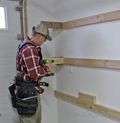 BEST DIY Garage Shelves (Attached to Walls) Easy and Fast DIY Garage or Basement Shelving for Tote Storage (Attached to Walls) Basement Shelving, Garage Storage Shelves, Garage Shelf, Tote Storage, Garage Organization, Garage Doors, Garage Workbench, Garage Walls, Wall Shelving
