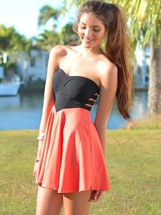 minidress: black slit-cutout-back strapless sweetheart-top corset top, peach gathered skirt
