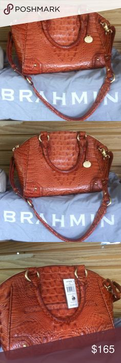 BRAHMIN PURSE GEOURGEOUS! In love with this purse and the color. Never been used. NWT. 1 outside pouch, 2 inside pouches, 2 pen holders, and two zipper pouches. Cross body strap included and Brahmin bag included with purse Brahmin Bags