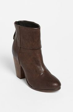 Stacked heel lifts a versatile and ultrachic leather bootie. Great with skinny jeans.