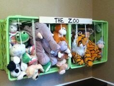 Like this stuffed animal zoo- cheap plastic baskets and elastic.