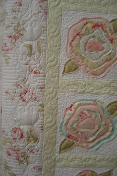 .Pieced by Sean Davy. Quilted by Jessica's quilting studio. Appliqué flowers in pastels