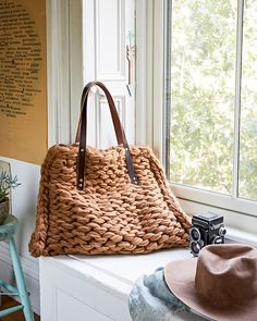 I adore this oversized arm-knit tote. The scale of it feels graphic and modern, and the leather handles add just the right finish. Line it with a bright, fresh floral print and you'll have a bag that will make you happy every day!
