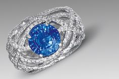 18K white gold, consisting of a round sapphire size of 4.79 carats and 256 brilliant cut diamonds. | Chanel Joaillerie