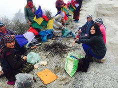 We met these gorgeous Arunachali women tying prayer flags across the mountains for good luck. They very generously shared the fire they had going, with me.