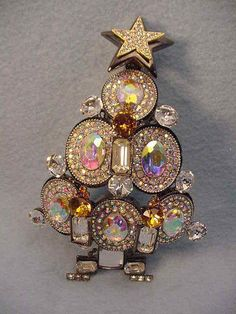 "Larry Vrba beautiful extra large Aurora Borealis crystal Christmas tree pin that can also be worn as a necklace. It has three candles on the front and a star on the top of the tree and it is 6"" 1 tall and in excellent condition. 