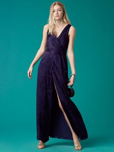 DVF Sleeveless Floor-Length Wrap Dress | Cut in a brilliant navy hue, this wrap elegant and floor-length wrap-style dress features a V-neck and a clean seam under the bust.