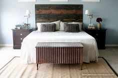 Just add a headboard made from pre cut and stained boards screwed onto the wall.