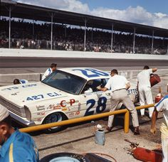 NASCAR - those were the days! No helmets, smoking in the pits............
