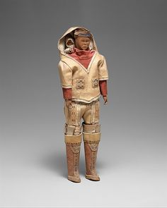 Doll with Child Date: late 19th century Geography: Greenland Culture: Eskimo Medium: Wood, native-tanned skin, pigment, cotton Dimensions: H. 12 x W. 4 1/2 in. (30.5 x 11.4 cm) Classification: Wood-Sculpture Credit Line: Ralph T. Coe Collection, Gift of Ralph T. Coe Foundation for the Arts, 2011
