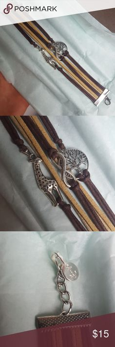 Leather infinity bracelet Different color bands of leather Giraffe charm, infinity charm, tree charm Never worn Jewelry Bracelets