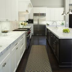 Pretty much my dream kitchen. White shaker cabinets, marble counters and backsplash, wood floors and a large dark center island! White Shaker Cabinets, White Kitchen Cabinets, Kitchen White, Chevron Kitchen, Gold Kitchen, Wall Cabinets, Black Cabinets, Upper Cabinets, Kitchen Appliances