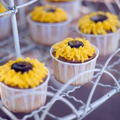 sunflower cupcakes - yelow frosting with fudge icecream topping in middle