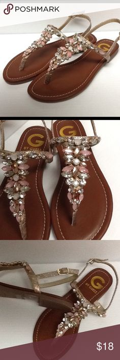 Guess jeweled Sandals Brand new in original box. Style name of Leesure. Flat sandals with jeweled fronts. Gold in color.All synthetic materials. Heel is .25 G by Guess Shoes Sandals