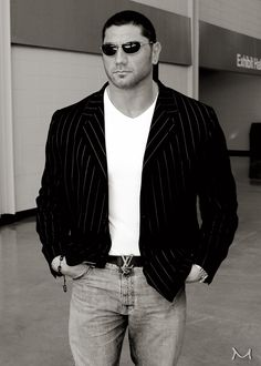 Gorgeous. He is jus gorgeous. The things I can imagine he could do outta the ring.....mmm. Batista