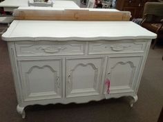 $275 - This is a country French style petite buffet that has been painted a creamy white and distressed. Two drawers, one fitted out for silverware and three cabinet doors below for storage. This piece measures 48 inches across the front, 20 inches deep and it stands 32 inches tall. It can be seen in booth H 12 at Main Street Antique Mall 7260 East Main St ( E of Power Rd ) Mesa 85207  480 9241122open 7 days 10 till 530 Cash or charge 30 day layaway also available