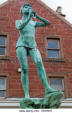 The statue of Peter Pan is in the center of Kirriemuir, Scotland, the birthplace of JM Barrie, the creator of Peter - Stock Image