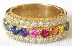 s! This truly exceptional ring is made with 1.5 carats (9 stones) of 3mm round cut rainbow sapphires and 26 very fine sparkling diamonds which enhance the glorious rainbow. All set in a heavy and thick 14k gold band, this ring is comfortable and easy to wear. Found at MyJewelrySource.