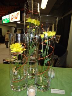 Wire wrapped around inside of a vase- with single flower inside