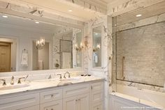 Stunning bathroom design with beautiful marble countertops, walls and backsplash.
